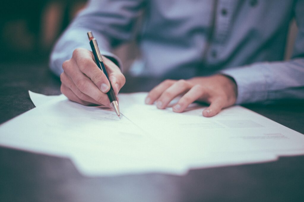 Mortgage advisor signing a contract